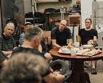 Men gathered in conversation in the men's shed at Sunshine Uniting Churxh